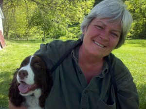 Linda Kaim, owner of Lionheart K9 and an English Springer Spaniel puppy